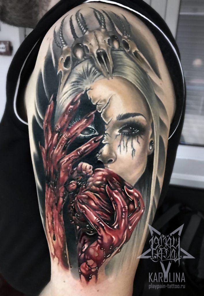 Девушка с сердцем, татуировка в реализме на руке